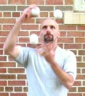 juggling white ball bricks